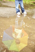 Girl with an umbrella in the rain — Stock Photo