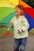Girl with an umbrella in the rain — Stock Photo
