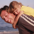 Father and daughter on the sea shore — Stock Photo