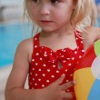 Beautiful little girl in the water pool — Stock Photo