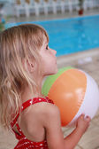 Beautiful little girl in the water pool — Stock Photo