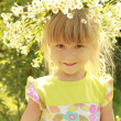 Stock Photo: Beautiful little girl in wreath of flowers on nature