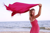 Pregnant woman with a scarf on the beach — Stock Photo