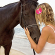 Girl with a horse by the sea — Stock Photo