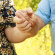 Two hands of an elderly couple in love — Stock Photo