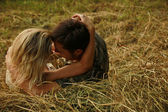 Couple in love on a haystack in nature — Stock Photo