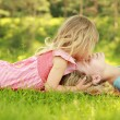 Mama and her little daughter playing on grass — Foto Stock