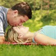 Couple in love outdoors lying on the grass — Stock Photo