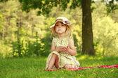 Beautiful little girl on nature — Stock Photo