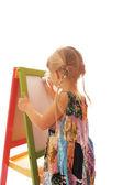 Girl draws on a white background — Stock Photo