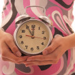 The pregnant woman on a white background with a clock — Stock Photo