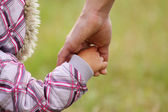 Parent holds the hand of a child — Stock Photo
