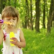 Little girl with soap bubbles — Stockfoto