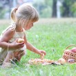 Beautiful little girl with apples — Stock Photo