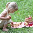 Stock Photo: Beautiful little girl with apples