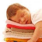 Newborn baby lying on towels — Stock Photo