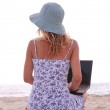 Girl with laptop on the beach — Stock Photo #39694583