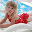 Stock Photo: Girl lying beside pool