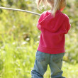 Stock Photo: Beautiful little girl in nature playing with stick