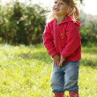 Stock Photo: Beautiful little girl playing in nature