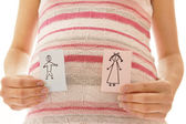 Pregnant woman with stickers — Stock Photo