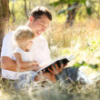Father with daughter reads  Bible — Stock Photo #45576169