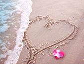 Heart in the sand on the seashore  — Stock Photo