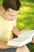 A young man reading the Bible  — Stock Photo
