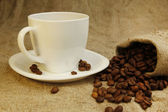 Coffee mug and coffee beans — Stock Photo