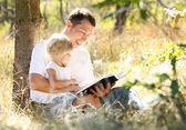 Father with daughter reads  Bible — Stock Photo