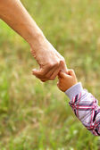 Hand of parent and child — Stock Photo