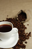 Coffee mug and coffee beans — Stock Photo