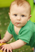 Beautiful little boy with a children's house  — Stock Photo