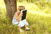 Young girl reads the Bible — Stock Photo