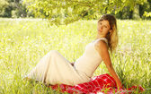 Belly of a pregnant woman on nature — Stock Photo