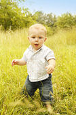 Child standing in nature — Stock Photo