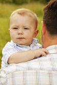 Baby on father's hands — Stock Photo