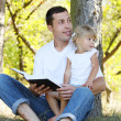 Father with daughter reads the Bible — Stock Photo #48140219