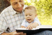 Father with son reading the Bible — Foto de Stock
