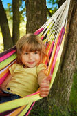 Girl with smartphone in hammock — Stock Photo