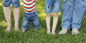 Family feet in jeans — Stock Photo