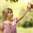 Girl takes ice cream from hand — Stock Photo #49635739