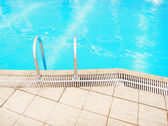 Step in the blue pool water — Stock Photo