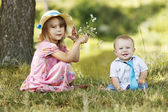 Little brother and sister playing on the nature  — Stock Photo