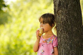 Little girl eating ice cream — Stock Photo