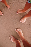 Family footprints on beach — Stock Photo