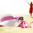 Girl with slippers and hat on the beach — Stock Photo #51331225