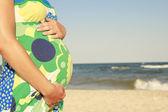 Pregnant woman on the beach — Stock Photo