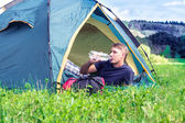 A tourist in a tent — Stock Photo