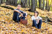 The couple in an autumn wood — Stock Photo